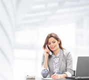 A businesswoman in formal clothes on the phone Royalty Free Stock Images