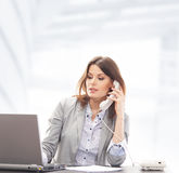A businesswoman in formal clothes on the phone Stock Photography
