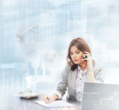 A businesswoman in formal clothes on the phone Stock Photos