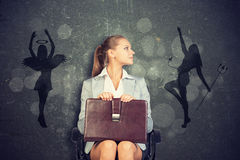 Businesswoman Framed by Shadow of Angel and Devil Stock Images