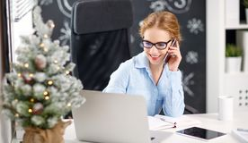 Businesswoman freelancer working at a computer at Christmas Royalty Free Stock Image