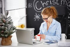 Businesswoman freelancer working at a computer at Christmas Stock Images