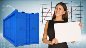 Businesswoman with freight shipping container. Businesswoman hold white paper. Freight shipping container and graphs as backdrop Royalty Free Stock Images