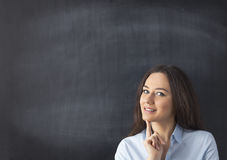 Businesswoman in front of blackboard Royalty Free Stock Images