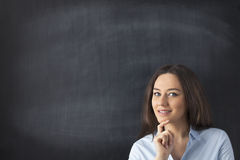 Businesswoman in front of blackboard Royalty Free Stock Photography