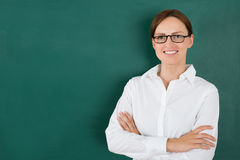 Businesswoman In Front Of Blackboard Stock Photos