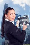 Businesswoman in the front of a business district Stock Images