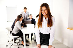 Businesswoman in front of business meeting Stock Photos