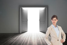 Businesswoman in front of a generated door Royalty Free Stock Photography