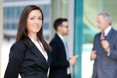 Businesswoman in front of her colleagues Royalty Free Stock Photography