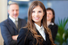 Businesswoman in front of her team Royalty Free Stock Images