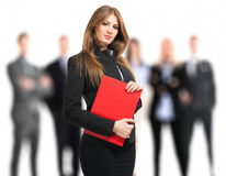 Businesswoman in front of her team Stock Image