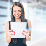 Businesswoman in front of office building holding tablet Stock Photos