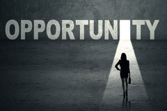 Businesswoman in front of opportunity door Royalty Free Stock Photography