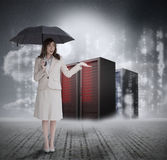 Businesswoman in front of servers holding umbrella Stock Photography