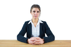 Businesswoman frowning at the camera Royalty Free Stock Photo