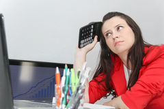 Businesswoman frustated with work, has a lot of work at the offi Stock Image