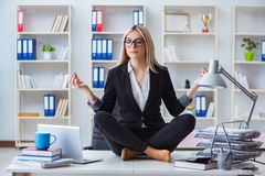 The businesswoman frustrated meditating in the office. Businesswoman frustrated meditating in the office Royalty Free Stock Photos