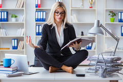 The businesswoman frustrated meditating in the office. Businesswoman frustrated meditating in the office Royalty Free Stock Image