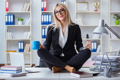 The businesswoman frustrated meditating in the office. Businesswoman frustrated meditating in the office Stock Images