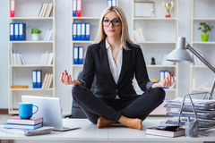 The businesswoman frustrated meditating in the office. Businesswoman frustrated meditating in the office Royalty Free Stock Images
