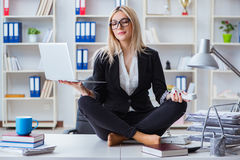 The businesswoman frustrated meditating in the office. Businesswoman frustrated meditating in the office Stock Image