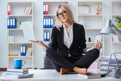 The businesswoman frustrated meditating in the office. Businesswoman frustrated meditating in the office Stock Photography