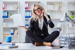 The businesswoman frustrated meditating in the office. Businesswoman frustrated meditating in the office Stock Photos