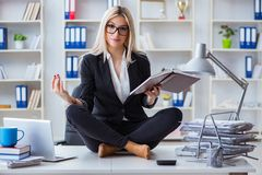 The businesswoman frustrated meditating in the office. Businesswoman frustrated meditating in the office Royalty Free Stock Photo
