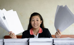 Businesswoman frustrated and raise up papers into the air Stock Images
