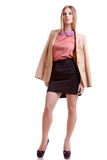 Businesswoman full body in jacket on white background Stock Photography