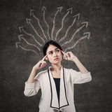 Businesswoman full of doubts Royalty Free Stock Image
