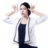 Businesswoman with funny expression Stock Photos