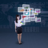 Businesswoman and futuristic interface Royalty Free Stock Photos