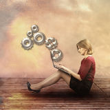 Businesswoman with gear wheel elements Stock Photo