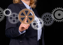 Businesswoman and gears Royalty Free Stock Image