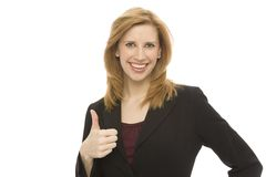 Businesswoman gestures. A busineswoman gestures a thumbs-up Stock Photography