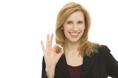 Businesswoman gestures. A businesswoman in a suit gestures ok Royalty Free Stock Images
