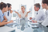 Businesswoman gesturing as she ignores something. During a meeting Stock Image