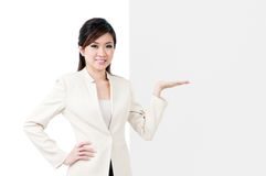 Businesswoman Gesturing At Blank Billboard Royalty Free Stock Photography