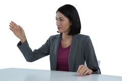 Businesswoman gesturing at desk Royalty Free Stock Image