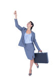 Businesswoman gesturing and holding briefcase Royalty Free Stock Photography