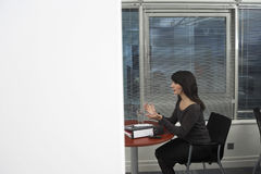 Businesswoman Gesturing During Office Meeting Stock Photography