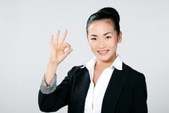 Businesswoman gesturing OK Royalty Free Stock Photo