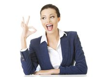 Businesswoman gesturing ok sign Royalty Free Stock Image