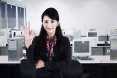 Businesswoman gesturing okay 2 Stock Images