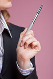 Businesswoman gesturing with pen Stock Photography