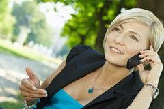 Businesswoman gesturing talking on mobile phone Royalty Free Stock Photos