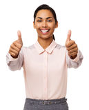 Businesswoman Gesturing Thumbs Up Against White Background Stock Photo