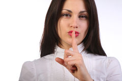 Businesswoman gesturing to silence Stock Images